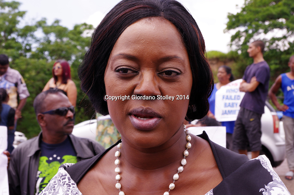 DURBAN - 4 December 2014 - Nokuthula Khanyile, the head of the KwaZulu-Natal Social Development department speaks to the media at a protest outside the Chatsworth Magistrate's Court where Patricia Ishwalal and her mother Salatchee Basanich appeared. Ishwalal and her mother are accused of murdering Ishwalal's three-and-a-half year old duaghter Jamie Naidoo. Picture: Allied Picture Press/APP