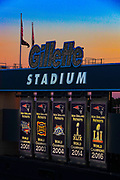 The New England Patiots fivfe Super Bowl banners are shown on Sunday, Nov. 4, 2018 as the sun sets behind them prior to the Patriots game against the Green Bay Packers in Foxboro. Eric J. Adler [New England Patriots] via AP Images