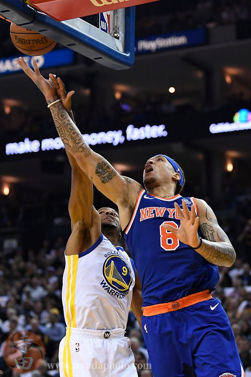 January 23, 2018; Oakland, CA, USA; New York Knicks forward Michael Beasley (8) shoots the basketball against Golden State Warriors forward Andre Iguodala (9) during the first quarter at Oracle Arena.