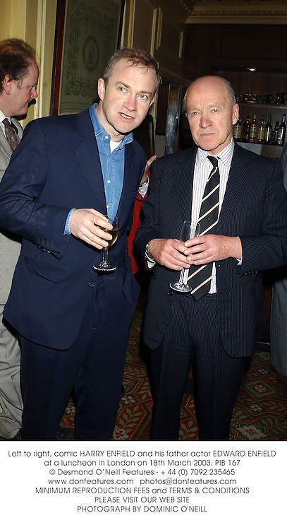 Left to right, comic HARRY ENFIELD and his father actor EDWARD ENFIELD at a luncheon in London on 18th March 2003.PIB 167