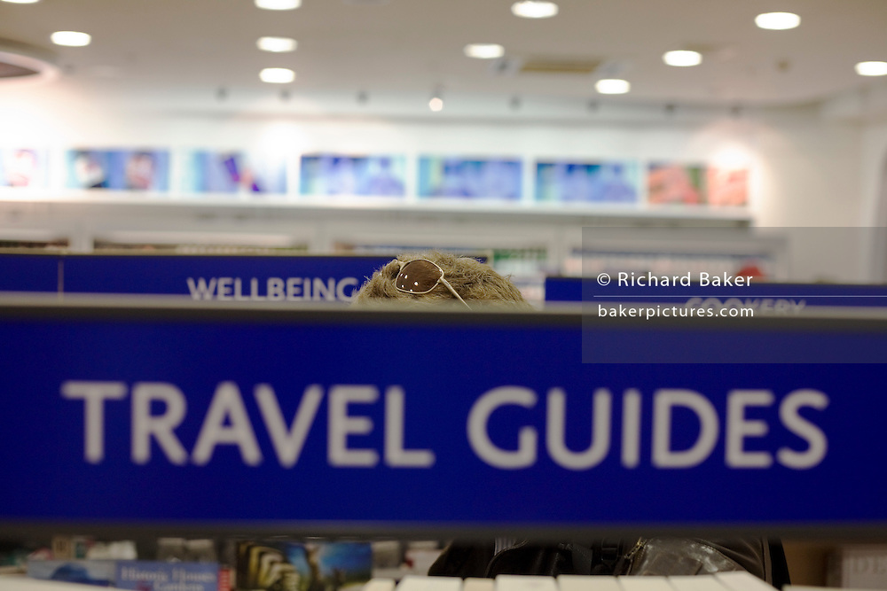 WH Smiths travel literature on sale in departures shopping area of Heathrow airport's Terminal 5.