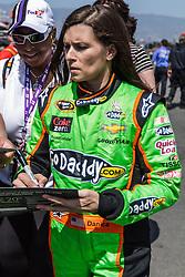 Fontana, CA/USA (Saturday, March 23, 2013) -  NASCAR Sprint Cup Series Driver Danica Patrick signs autographs for her fans at GoDaddy's garage at the Auto Club Speedway in Fontana, CA.  PHOTO © Eduardo E. Silva/SILVEX.PHOTOSHELTER.COM.