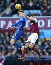 Aston Villa's Mile Jedinak (right) and Birmingham City's Sam Gallagher battle for the ball