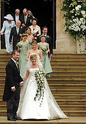 Peter Phillips and Autumn Kelly leave St. George's Chapel after their marriage ceremony at Windor Castle, Windsor.