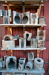 Old wooden moulds for making glass at glassmaking workshop in Skansen open air museum in Stockholm Sweden 2009