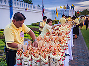 09 JUNE 2016 - BANGKOK, THAILAND:   People set out offerings for monks in front of the Grand Palace. Thailand marked 70 years of the reign of Bhumibol Adulyadej, the King of Thailand, with a special alms giving ceremony for 770 monks in front of the Grand Palace in Bangkok. The King, also known as Rama IX, ascended the throne on 9 June 1946. He is the longest serving monarch in Thai history and the longest serving monarch in the world today. He is revered by most Thais and is widely seen as a unifying figure in the country.    PHOTO BY JACK KURTZ