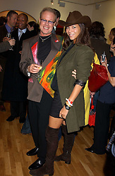 Artist JEFFREY KROLL and stylist MISS CHARLOTTE STOCKDALE at an exhibition of art by Jeffrey Kroll entitled Imirage held at the Arndean Gallery, Cork Street, London on 19th October 2005.<br /><br />NON EXCLUSIVE - WORLD RIGHTS