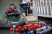 Asylum seekers arriving into Dover docks on board a Boarder Force RIB boat after being rescued in the English Channel while crossing on the 31st of March 2021 in Dover, Kent, United Kingdom. About 30 men and women arrived today on two small boats they were taken off the boat by UK Boarder Force and taken into a processing centre on the dock side.