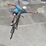 Andre Loo, 20, from Queenstown, in action during the Gorge Road Mega Jam, for BMX and Mountain Bike riders to mark the opening  of the Gorge Road Jump Park run by the Queenstown Mountain Bike Club,  Queenstown, New Zealand. 3rd December 2011. Photo Tim Clayton