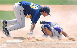Kosuke Hattori of MSU slides back to first base after trying to steal second base and; avoids being tagged out by Augustana first baseman.