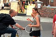 Woman age 23 talking to friend on bike age 25.  Torun Poland