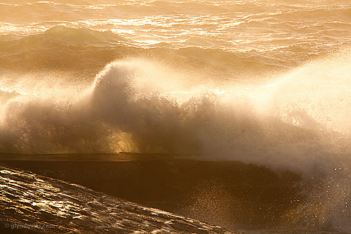 We may not have had the week of baking sunshine and relaxing swimming but from a photography perspective the gales and storms brought superb conditions and lighting. The jetty at Sennen always takes a pounding from the Atlantic but the golden evening sunshine disguised the awesome power of the Atlantic swell.