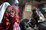 Ikhbal, wife of deceased Abdul Rashid Khan, smoking a cigarette..Inside Mustafa Qol's house..At the camp of Tash Seri (Mustafa Qol's camp)...Trekking through the high altitude plateau of the Little Pamir mountains, where the Afghan Kyrgyz community live all year, on the borders of China, Tajikistan and Pakistan.