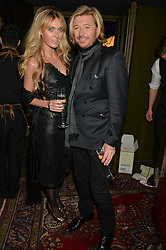 NICKY CLARKE and KELLY SIMPKIN at a party to celebrate the 1st anniversary of Hello! Fashion Monthly magazine held at Charlie, 15 Berkeley Street, London on 14th October 2015.