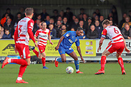 AFC Wimbledon attacker Michael Folivi (41) dribbling and taking on a number of Doncaster Rovers players during the EFL Sky Bet League 1 match between AFC Wimbledon and Doncaster Rovers at the Cherry Red Records Stadium, Kingston, England on 9 March 2019.