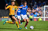 Portsmouth Midfielder, Gareth Evans (26) takes on Cambridge United Defender, Jake Carroll (19) during the EFL Sky Bet League 2 match between Portsmouth and Cambridge United at Fratton Park, Portsmouth, England on 22 April 2017. Photo by Adam Rivers.