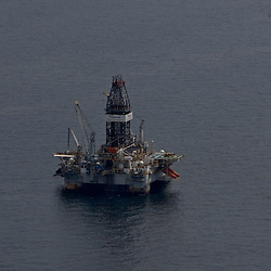 Oil is seen on the surface of the water around the Transocean Development Driller II, which is drilling a relief well, at the site of the Deepwater Horizon oil spill in the Gulf of Mexico near the coast of Louisiana, U.S., on Wednesday, June 2, 2010. BP Plc has given up trying to plug its leaking well in the Gulf of Mexico any sooner than August, laying out a series of steps to pipe the oil to the surface and ship it ashore for refining, said Thad Allen, the U.S. government's national commander for the incident. Photographer: Derick E. Hingle