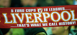 LIVERPOOL, ENGLAND - Wednesday, December 15, 2010: Liverpool supporters on the Spion Kop hold their scarves aloft during the UEFA Europa League Group K match against FC Utrecht at Anfield. Fans on the Kop are known as Kopites. (Photo by: David Rawcliffe/Propaganda)