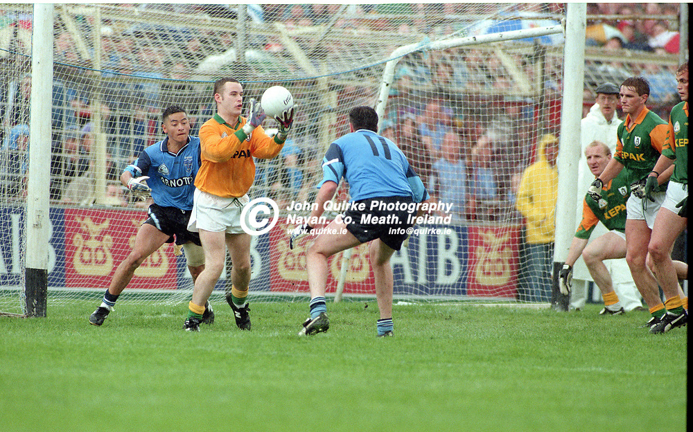 28-07-1996. Meath v Dublin - Leinster SFC Final at Croke Park.<br /> Meath goalkeeper Conor Martin about to send out a pass as Jason Sherlock and Pat Gilroy ( 11) challenge.<br /> Photo: John Quirke / www.quirke.ie<br /> ©John Quirke Photography, 16 Proudstown Road, Navan. Co. Meath. (info@quirke.ie / 046-9028461 / 087-2579454).