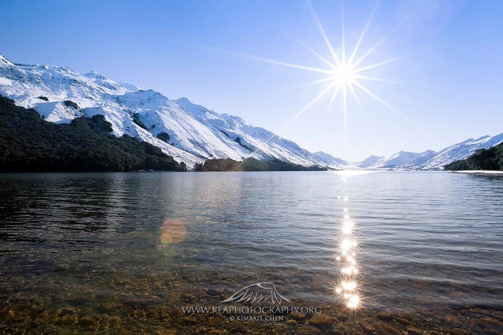 Lake Mavora draped in a winter wonderland!  A necklace of sunstars reflect onto the lake's surface.
