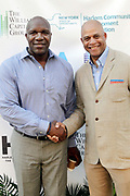 May 14, 2014- Harlem, New York-United States: (L-R) Former Professional NFL Player Marvin Washington and Eric Pryor, President, Harlem School of the Arts attend the Harlem School of the Arts Jump and Wave Benefit held at the Harlem School of the Arts- The Herb Alpert Center on May 18, 2017 in Harlem, New York City. Harlem School of the Arts enriches the lives of young people and their families through world-class training in and exposure to the arts across multiple disciplines in an environment that emphasizes rigorous training, stimulates creativity, builds self-confidence, and adds a dimension of beauty to their lives.(Photo by Terrence Jennings/terrencejennings.com)