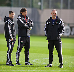 NEWPORT, WALES - Wednesday, October 8, 2014: Wales' manager Chris Coleman with head of fitness and science Ryland Morgans and coach Kit Symons at Dragon Park National Football Development Centre ahead of the UEFA Euro 2016 qualifying match against Bosnia and Herzegovina. (Pic by David Rawcliffe/Propaganda)