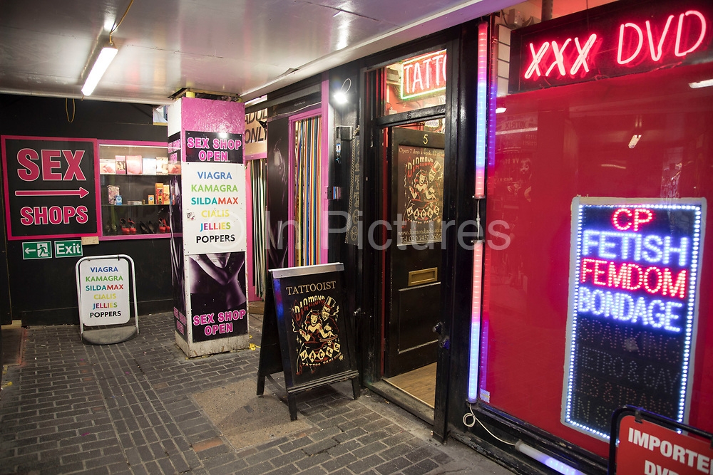 Adult sex shop in Soho, central London, United Kingdom. In Walker's Court, this seedy alley, there were once sex shops, DVD shops, live sex shows and all manner of pornographic offerings, but now it is all but closed and being redeveloped and gentrified. Walkers Court is a pedestrian street in the Soho district of the City of Westminster. The street dates from around the early 1700s and escaped modernisation in the late nineteenth century so that it retains its original narrow layout. In the twentieth century the small shops that traded from the street gradually closed and from the late 1950s the street became associated with Sohos sex trade.