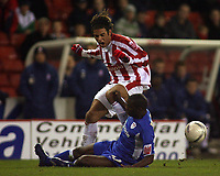 Photo: Paul Thomas.<br /> Stoke City v Millwall. The FA Cup. 05/01/2007.<br /> <br /> Darel Russell of Stoke (Red) gets hit in a sliding tackle by Marvin Williams.