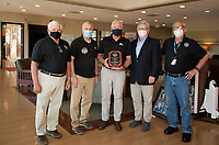Ken Costa NHPA, David DeVries NHPA, Marv Everson Laconia Airport, Mayor Andrew Hosmer and Roger Pascoe NHPA award Everson with New Hampshire Pilots Association Manager of the Year Award on Thursday afternoon at the Laconia Airport.  (Karen Bobotas Photo/for The Laconia Daily Sun)