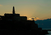 Israel, Tel Aviv, Jaffa, The silhouette of the Old Jaffa and the entrance to the port at sunset