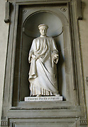 Statue located outside of the Uffizi museum in Florence, Italy. One of the oldest art museums in the Western World. Semi enclosed figurative statues such as this appear all over Florence. Statue of Cosimo de'Medici, first of the Medici political dynasty, and ruler of Florence. Given the title 'Pater Patriae' or 'Father of the Nation' which is inscribed on this statue.