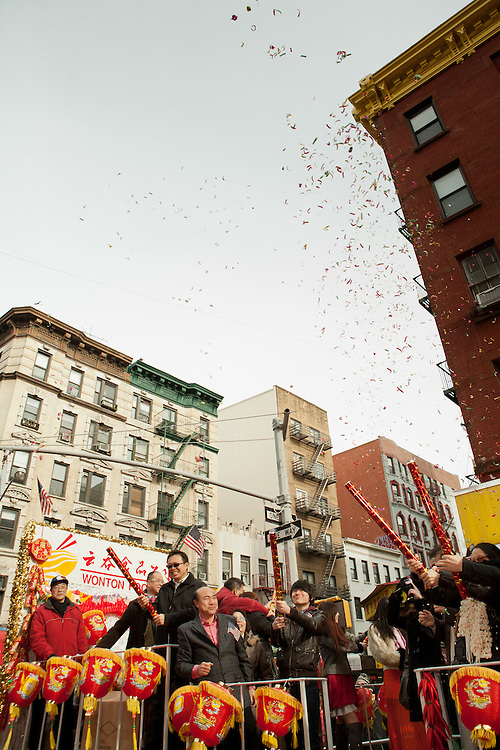 Members of the Chinese Restaurant Association popping party poppers full of confetti.