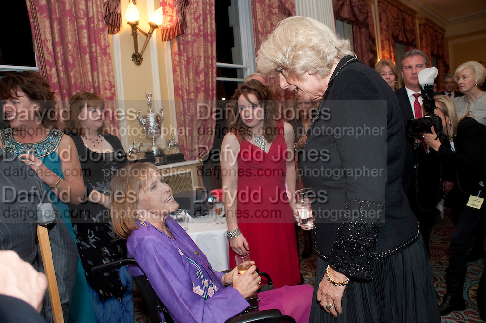 ANNE DUNHAM; NATASHA BAKER; CAMILLA DUCHESS OF CORNWALL, The Lady Joseph Trust, fundraising party.<br /> Camilla, Duchess of Cornwall  attends gala fundraising event as newly appointed President of the charity. The Lady Joseph Trust was formed in 2009 to raise funds to acquire horses for the UKÕs top Paralympic riders Cavalry and Guards Club, 127 Piccadilly, London,<br /> 26 October 2011. <br /> <br />  , -DO NOT ARCHIVE-© Copyright Photograph by Dafydd Jones. 248 Clapham Rd. London SW9 0PZ. Tel 0207 820 0771. www.dafjones.com.<br /> ANNE DUNHAM; NATASHA BAKER; CAMILLA DUCHESS OF CORNWALL, The Lady Joseph Trust, fundraising party.<br /> Camilla, Duchess of Cornwall  attends gala fundraising event as newly appointed President of the charity. The Lady Joseph Trust was formed in 2009 to raise funds to acquire horses for the UK's top Paralympic riders Cavalry and Guards Club, 127 Piccadilly, London,<br /> 26 October 2011. <br /> <br />  , -DO NOT ARCHIVE-© Copyright Photograph by Dafydd Jones. 248 Clapham Rd. London SW9 0PZ. Tel 0207 820 0771. www.dafjones.com.