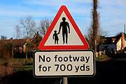Sign in village for No footway for 700 yards, Shottisham, Suffolk, England, UK