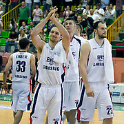 Efes Pilsen's players (Left to Right) Igor RAKOCEVIC, Dusan CANTEKIN, Ermal KURTOGLU during their Turkish Basketball league Play Off semi final first match Efes Pilsen between Besiktas at the Ayhan Sahenk Arena in Istanbul Turkey on Sunday 09 May 2010. Photo by Aykut AKICI/TURKPIX