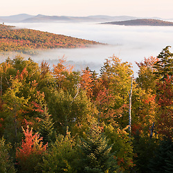 Morning fog as seen from the fire tower at Milan Hill State Park in Milan, New Hampshire.