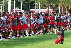 July 28, 2018 - Tampa, FL, U.S. - TAMPA, FL - JULY 28: The Tampa Bay Buccaneers players and staff including head coach Dirk Koetter stand at attention during the playing of the National Anthem before the Tampa Bay Buccaneers Training Camp on July 28, 2018 at One Buccaneer Place in Tampa, Florida. (Photo by Cliff Welch/Icon Sportswire) (Credit Image: © Cliff Welch/Icon SMI via ZUMA Press)