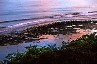 Sunset reflections on the shoreline of Gizo, Solomon Islands