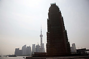 With the skyscrapers of Pudong's Lujiazui Financial District in the background, a scaffolding surrounds the Revolutionary Martyrs Monument, part of the historical riverside Bund renovation project in Shanghai, China on 27 May 2009.  60 years ago today residents of Shanghai woke up to find communist soldiers sleeping on the streets as the People's Liberation Army drove away the defending Nationalists after 15 days of intense fighting using only light weaponry to minimize collateral damage.