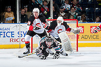 KELOWNA, CANADA - OCTOBER 23: Cole Linaker #26 of Kelowna Rockets is checked to the ice by Josh Anderson #28 of the Prince George Cougars on October 23, 2015 at Prospera Place in Kelowna, British Columbia, Canada.  (Photo by Marissa Baecker/Shoot the Breeze)  *** Local Caption *** Cole Linaker; Josh Anderson; Mack Shields;