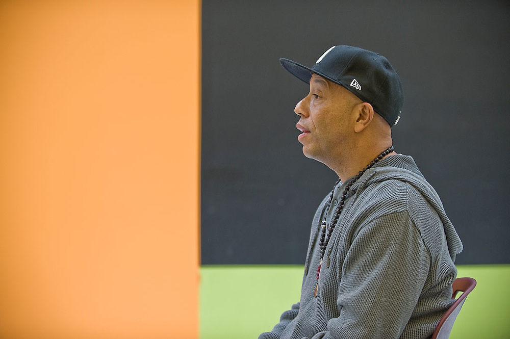 """Russell Simmons visits the Ideal Academy Public Charter School in Washington, DC to talk about Transcendental Meditation, """"Quiet Time"""" with the students, staff and principal, Dr. George H. Rutherford, PhD, Washington, DC, May 13, 2010."""