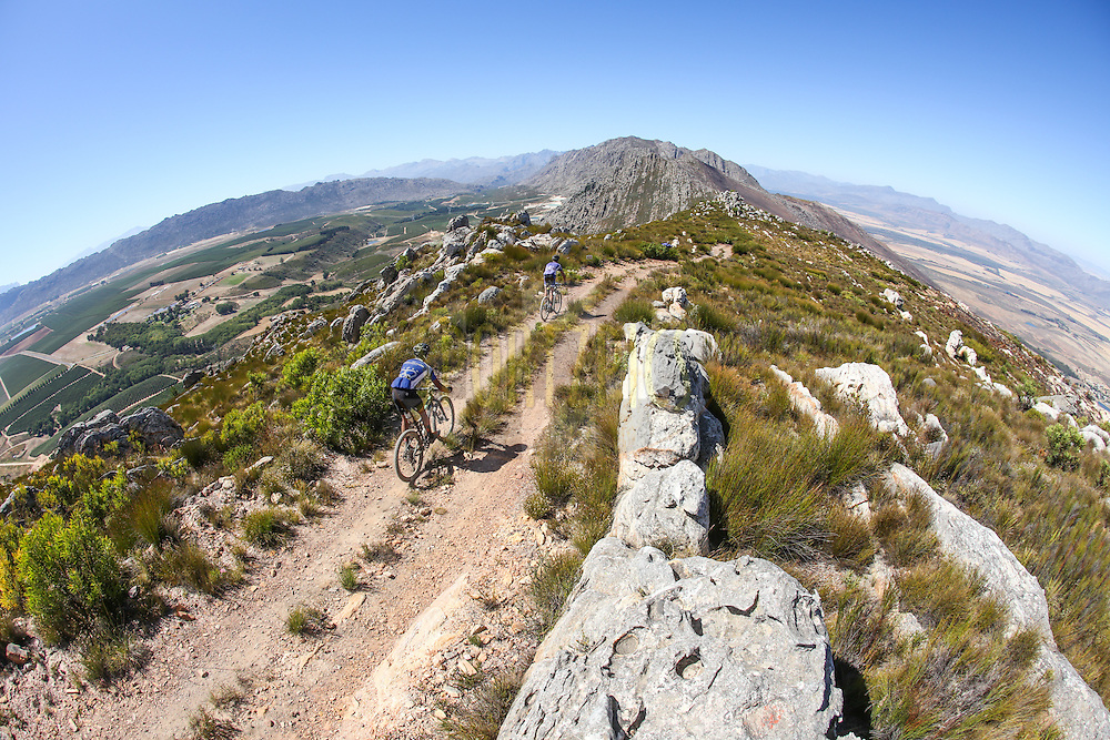 Riders traverse the Witzenberg Mountains ridgeline with the Witzenberg Valley to their left and the Tulbagh Valley to their right during Stage 1 of the Momentum Health Tankwa Trek, presented by Biogen, on 10 February 2017.