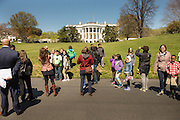 Students stop for photos in front of the White House as they walk to the White House Kitchen Garden on the South Lawn.