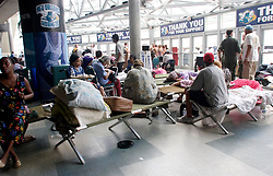 31st August, 2005. New Orleans, Louisiana.<br /> 'Hell on earth.' Saved from the Superdome in New Orleans, Louisiana where over 20,000 refugees from hurricane Katrina are crammed into hellish conditions, medical evacuees lie in cots at the New Orleans Arena across the road from the Superdome.<br /> Photo Credit: Charlie Varley/varleypix.com