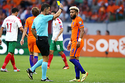 (l-r) referee Tasos Sidiropoulos, Tonny Vilhena of Holland during the FIFA World Cup 2018 qualifying match between The Netherlands and Bulgariaat the Amsterdam Arena on September 03, 2017 in Amsterdam, The Netherlands