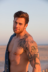hot man with a large tattoo on his shoulder and arm