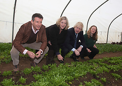 """© Licensed to London News Pictures. 23/02/2012. Wallington, Surrey. L-R: Seb Coe, Rosie Boycott, London Food Board, Boris Johnson and Anna Francis, Farm Manager. The Mayor of London, Boris Johnson and LOCOG Chairman Sebastian Coe today, 23 February 2012, showed off the benefits of urban food growing as they launched """"The Big Dig"""" volunteer gardening weekend (16-17 March). This is all in support of Capital Growth, a scheme to create 2,012 community food growing spaces by the end of 2012.  Photo credit: Bettina Strenske/LNP"""