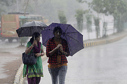 June 9, 2017 - Bhubaneswar, Orissa, India - Pedestrians look on the road as they are protecting in the umbrella in the pre-monsoon time in the eastern Indian state Odisha's capital city Bhubaneswar on 10 june 2017. (Credit Image: © Str/NurPhoto via ZUMA Press)