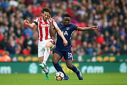 Tottenham Hotspur's Victor Wanyama (right) and Stoke City's Ramadan Sobhi battle for the ball