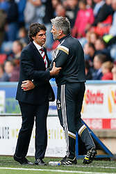 Manager Aitor Karanka of Middlesbrough leads his Goalkeeping coach Leo Percovich  away from an argument with New Manager Chris Powell, in his first game in charge of Huddersfield - Photo mandatory by-line: Rogan Thomson/JMP - 07966 386802 - 13/09/2014 - SPORT - FOOTBALL - Huddersfield, England - The John Smith's Stadium - Huddersfield town v Middlesbrough - Sky Bet Championship.